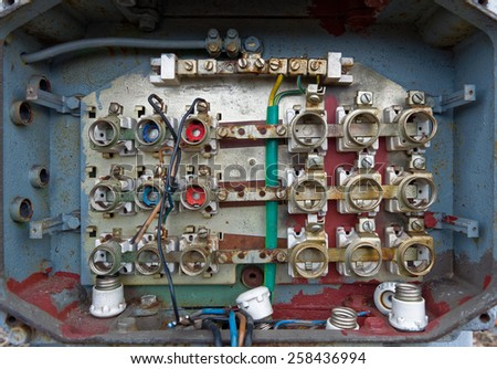 an old fuse box with cables and connectors #258436994
