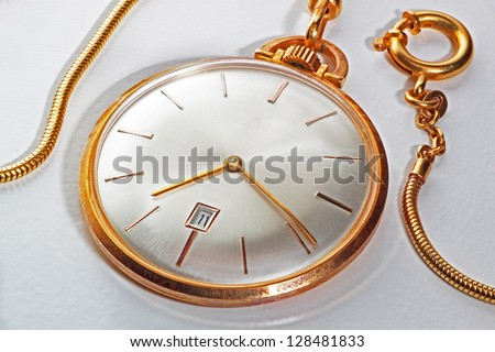 An old golden pocket watch with display in mother of pearl, vintage style