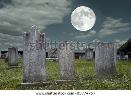 An old graveyard in the light of the full moon