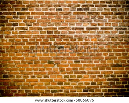 An old grunge looking brick wall usable as a background