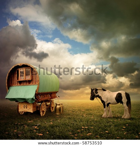 An Old Gypsy Caravan, Trailer, Wagon with a Horse - stock photo