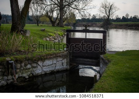 An old hand operated wheel of the gate on an irrigation canal in Italy ストックフォト ©