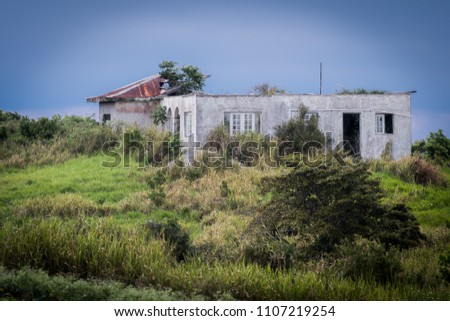 An old home met by destruction from a hurricane, in rural Jamaica.