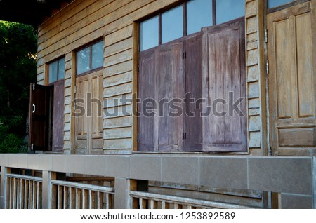 An old house along Mekong river in Chiang Khan district, Loei Province, Thailand, made of wood attached with wooden balcony for overlooking the view of the opposite coast that is Laos border #1253892589