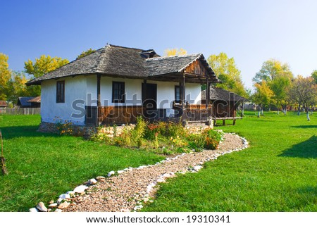 An old house with a long cobble ride in front from Romania