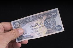 An old Iraqi banknote