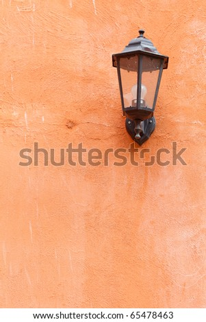 An old italian lamp isolated on orange wall