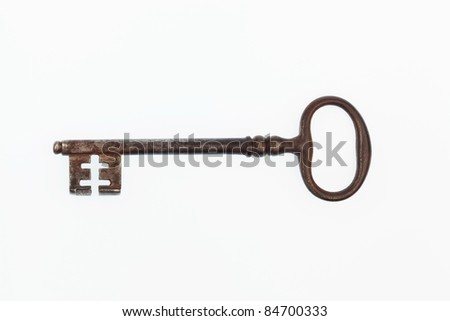 an old key lying on a white background