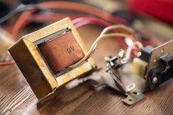 An old Laminated core transformer used to convert mains voltage to low voltage to power electronic devices.