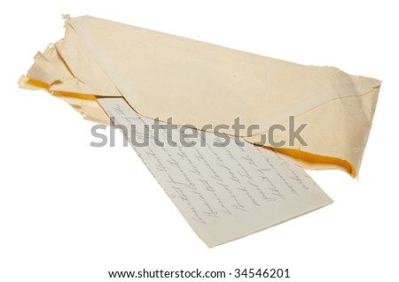 An old letter in a worn envelope with script handwriting isolated on a white background with a clipping path.