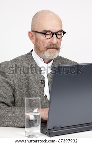 An old man with a grey beard on the notebook