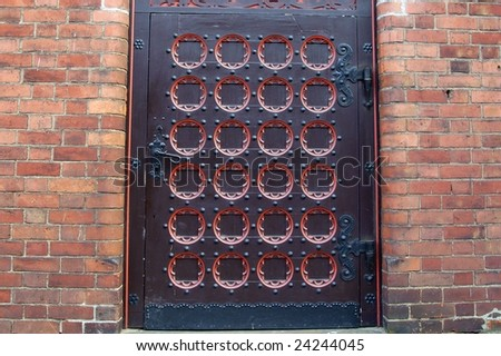 an old metal and wooden door - historic door