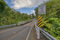 An old one lane bridge with a 12 ton weight limit sign near Hilo. Hawaii.