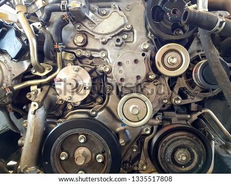 an old outdated engine, a closeup shot, engine car broken. #1335517808