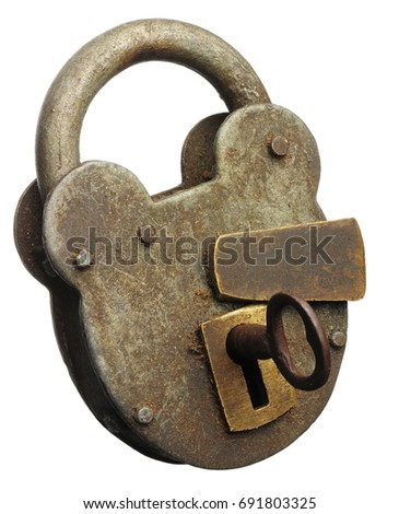 An old padlocked locked shut with the key in the lock #691803325