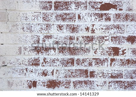 An old painted brick wall with paint peeling for background or texture