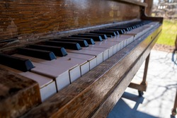 An old piano sits unused and in a state of disrepair in an outdoor music venue in Coldwater, Ontario.