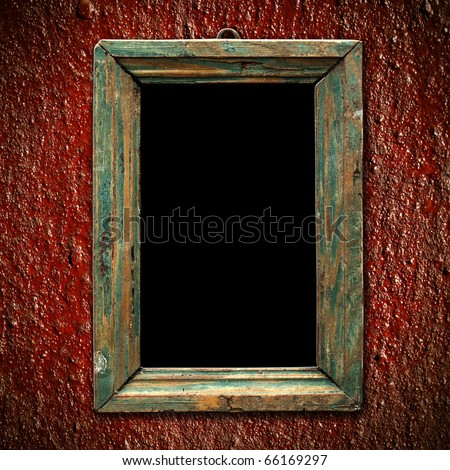An old picture frame on the red wall Vintage background