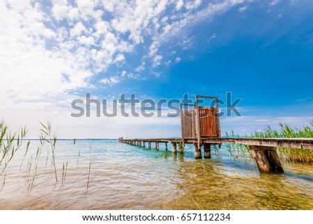An old pier in Lazise #657112234
