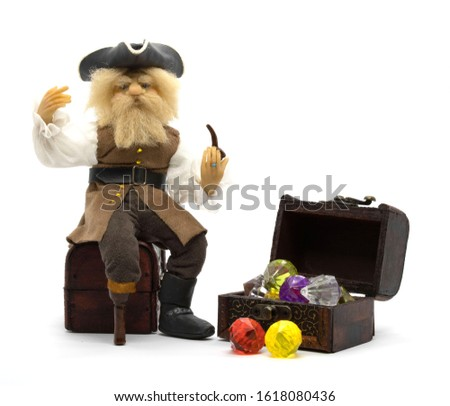 An old pirate, a sea robber, with his untold treasures.