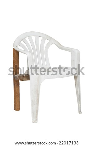 an old plastic broken chair is on white