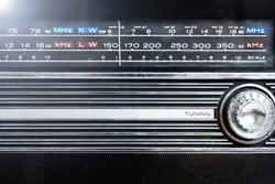 An old radio frequency tuning in abstract style. Retro background. Retro music concept. Music radio sound wave. Classic vintage design. Radio station signal.