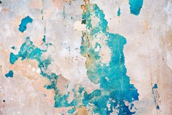 An old ragged blue plaster wall texture