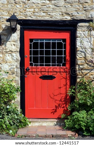An Old Red Door To The Front Of An English Country Cottage Stock Photo 124415