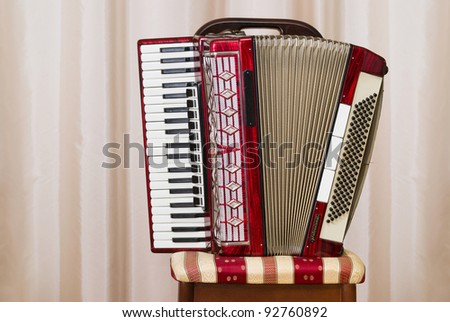 An old retro accordion is waiting for the player.