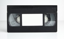 an Old retro vhs tape with a blank label for mock up, typography or graphics isolated on a white background. nostalgic 1980s music video cassette. obsolete media format.