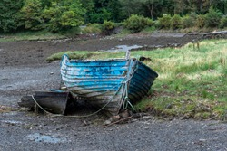 An old rowboat, abandoned on the dried up river bank.