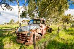An old rusted out abandoned truck rests on the roadside near the country town of York, Western Australia, Australia.