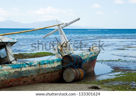 An old rustic beached fishing boat in Timor Leste