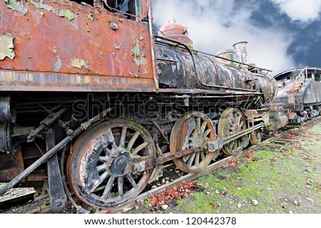 An old rusting vintage steam locomotive