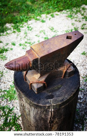 an old rusty anvil in a village smithy