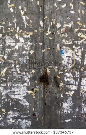 an old, rusty metal door with lot of scratches and peeling paint
