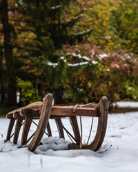 An old sled in the snow in a part of Germany