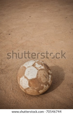 An old soccer ball on ground with copyspace