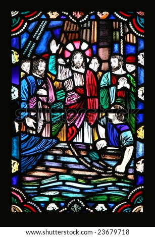 An old stained glass window featuring Jesus and the disciples in what looks to be a boat on water.