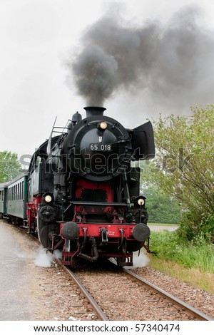 an old steam train on the track