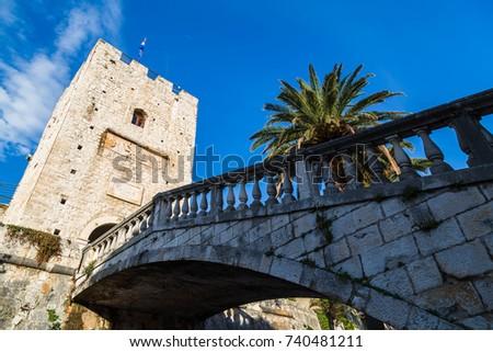 an old stone bridge comprising...