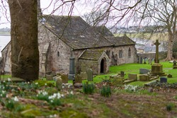 an old stone church and graveyard