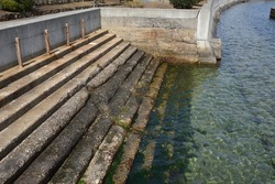 An old stone staircase facing the sea seen at Uno Port in Okayama Prefecture