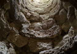 An old stone well from inside. Picture taken from below.