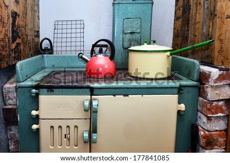 An Old Stove With Cookeries In Vintage Kitchen.