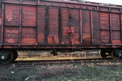 an old stretched railway carriage of a train from outside view.