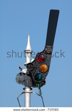 An old style railroad signal with semaphore arm. - stock photo