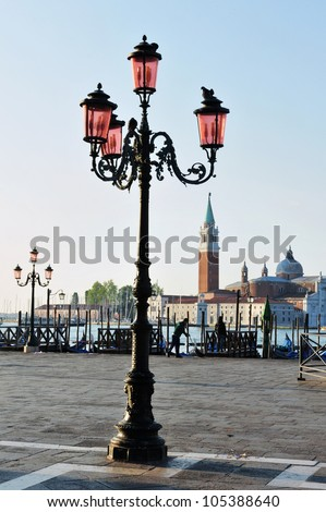 An old style street lamp in Piazza San Marco,  St Mark's Square, Venice, Italy.