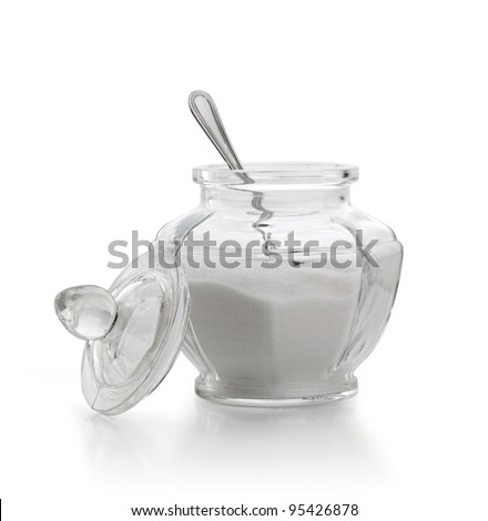 An old sugar bowl with spoon on white background
