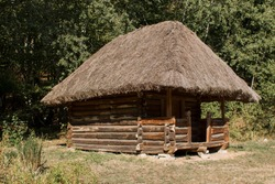 an old thatched house in the forest